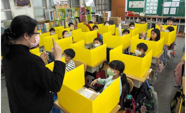niños escuela covid-19 china